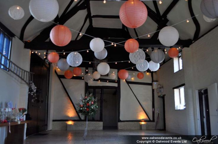 Beautiful scheme of peach, ivory, lace and grey lanterns on festoon lights with uplighting - at the Carriage Barn, Nether Winchendon House