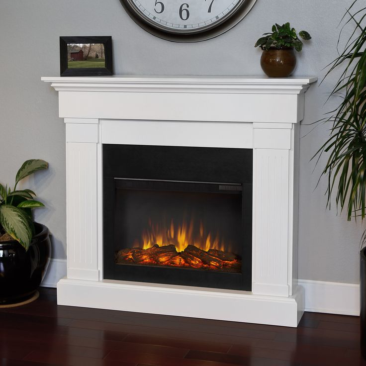 Warm your home on those cold winter nights with this realistic electric fireplace. Finished in a clean white color, this programmable fireplace plugs in to any standard outlet and comes with a remote control for easy operation.