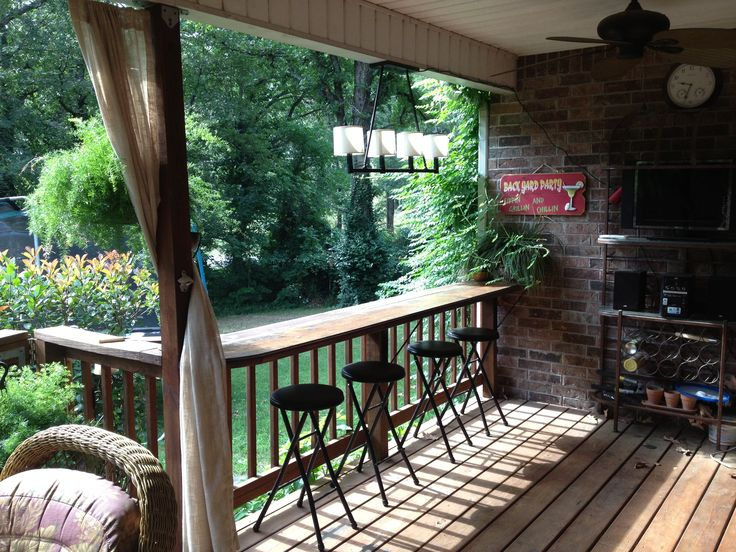 Wide surface on top of deck rail as bar/counter - maybe something like this on the patio under the deck?