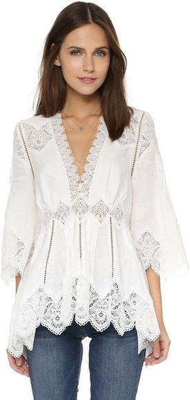 Sheer embroidery details the hem on this romantic linen Zimmermann top accented with a lattice trim. Pleats and a high-low hem accent the flowing silhouette. V neckline and 3/4 sleeves. Hidden side zip. Fabric: Plain weave. 100% linen. Dry clean. #youhabit #86olSbd0j