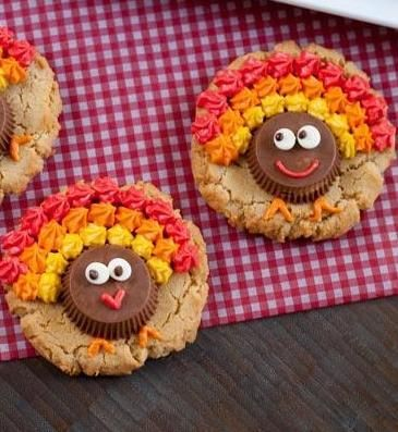 Peanut Butter Cup Turkey Cookies are a triple-shot of peanut butter - in the cookies, cups and creamy frosting! They'll be gobbled up in no time. Great for the Thanksgiving holiday - from  @bridgetedwards {bake at 350}