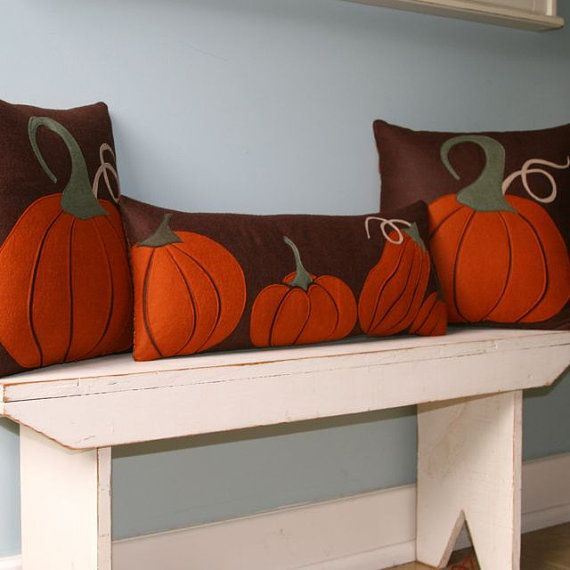 "Row of Pumpkins pillow for the bench on the porch.   Pillow measures 10"" x 24""    Front is hand-cut appliqued shapes, machine stitched onto a wool felt background with invisible thread. Back is cotton print with zipper closure.    Note - this listing is for Row of Pumpkins ONLY. For ""Pumpkin With Stem"" listing, please see this listing:"