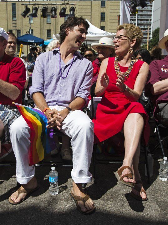 Liberal Party of Canada leader Justin Trudeau and Canada's first openly gay Ontario Premier Kathleen Wynne attend an outdoor church service before the gay pride parade in Toronto, June 30, 2013