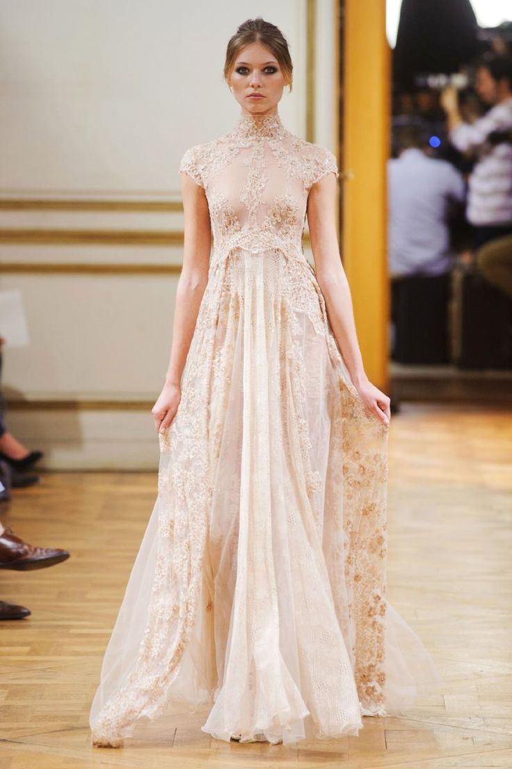 A dreamy high collar and sleeve lace wedding gown by Zuhair Murad!