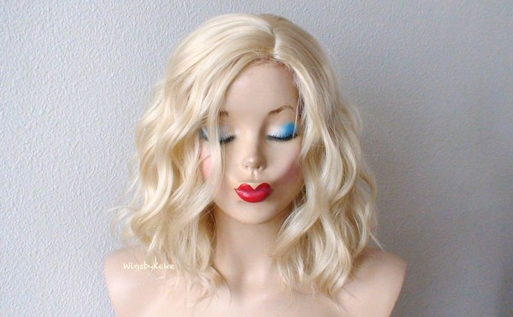 Blonde wig. Short wig. Beach waves hairstyle wig. Durable heat friendly synthetic wig for daily use or Cosplay. by KekeWigs on Etsy https://www.etsy.com/listing/190876482/blonde-wig-short-wig-beach-waves