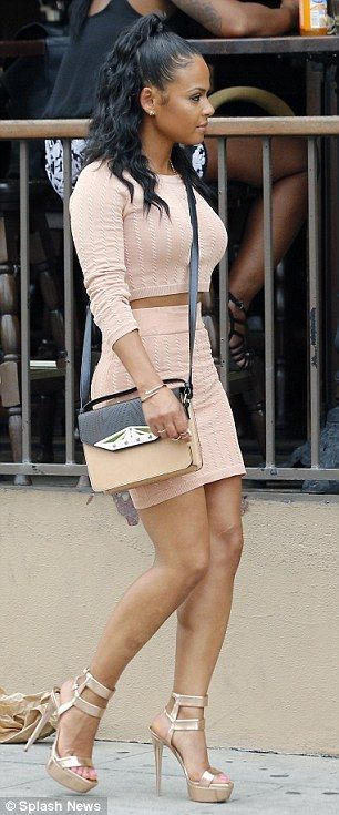 Sexy: The petite singer wore towering platform heels as she walked along a city street in ...