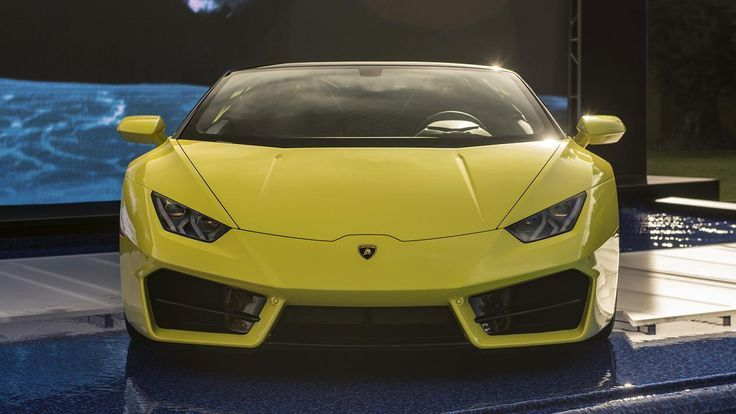 The sunshine-yellow rear-wheel-drive Huracan LP 580-2 Spyder was unveiled by Lam