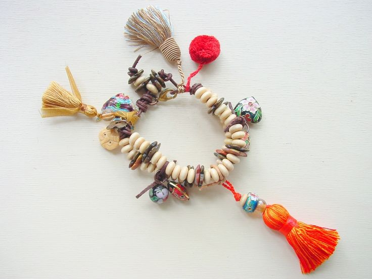Victoria White Designs Samba Rio Nat.JPG A fun and festive collection featuring pompons, ribbon, leather, wooded beads, and tassles galore! It was about Latin music, rythums, and colour.