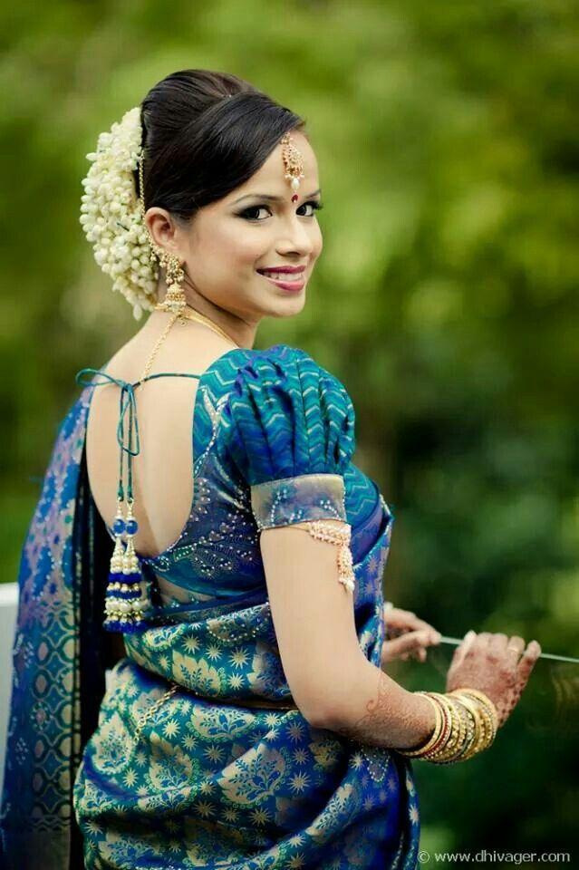 South Indian bride. Temple jewelry. Jhumkis.Blue silk kanchipuram sari.Braid with fresh jasmine flowers. Tamil bride. Telugu bride. Kannada bride. Hindu bride.Malayalee bride.Kerala bride.South Indian wedding.