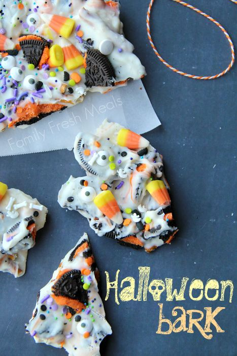 Halloween Bark - Fun Halloween Food  (could easily do with dairy-free white chocolate, GF sandwich cookies, and dye-free candies and sprinkles!)