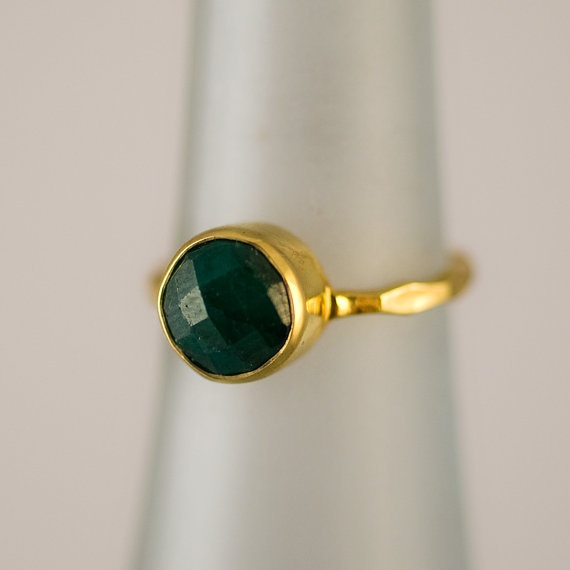 gold faceted emerald ring