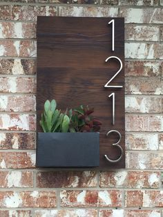 Beautiful custom house numbers plaque utilizing reclaimed wood and handmade metal planter box for succulents. My amazing man made!