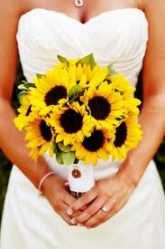 So this would be ALL sunflowers in the classic round bouquet.  It may be more than you had in mind, or it may be exactly what you were thinking - your call.