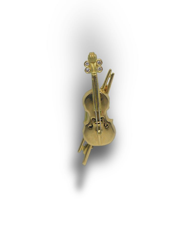 Broche en or jaune 750 millièmes en forme de violon poids total : 4,10 grs