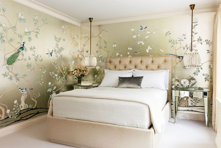 """""""The master bedroom and bath area is our client's retreat,"""" says Lichten. """"She requested a shift in palette in the private areas of her home. It's softer, calmer—silver, taupe, with icy blues and pastels."""" The hand-painted chinoiserie wall covering in the master bedroom points to this shift in mood. A pair of vintage Carl Fagerlund pendant lamps flank the bed."""