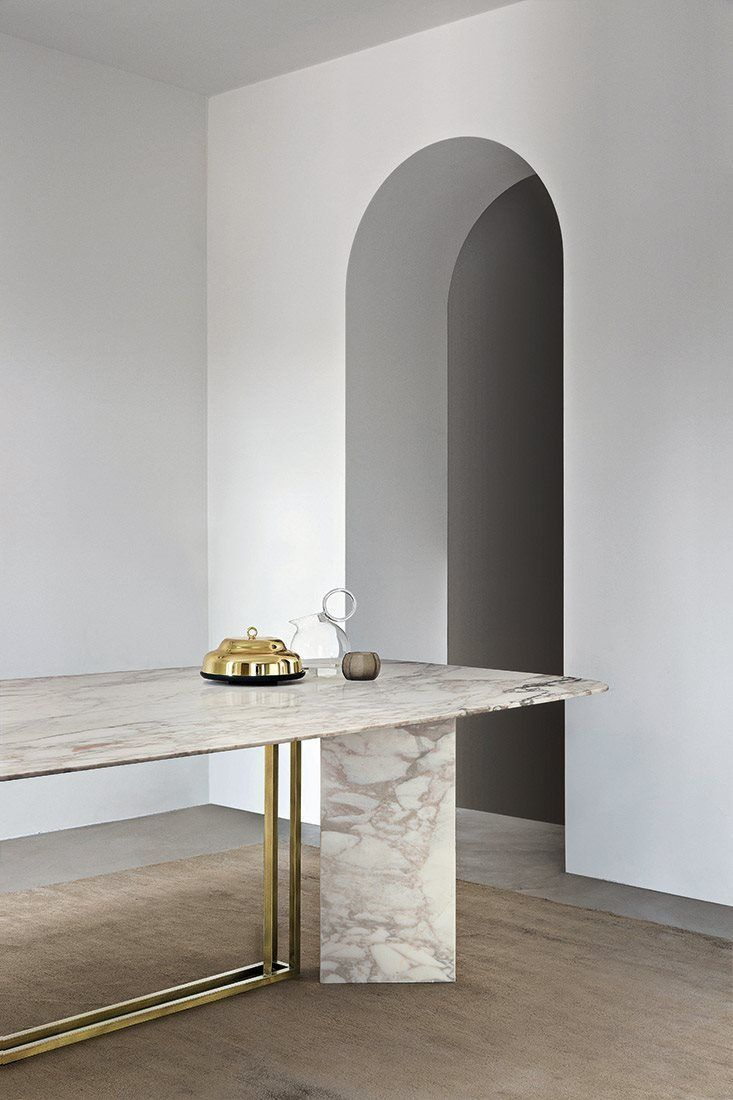 marble table and brass dining room