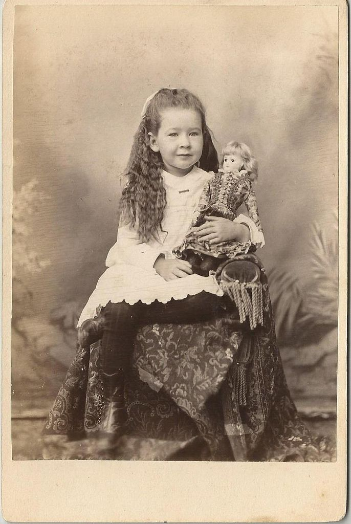 Taken by F. Metcalf of Boston, a charming child and a fancy bisque doll.