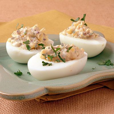 PROVENCAL DEVILED EGGS.  One 72-calorie egg contains just 1.6 grams of saturated fat and a multitude of nutrients: vitamins A and B12, and the antioxidant lutein, which nourishes the eyes and skin. Many of these nutrients are found in the egg yolk, so eat both yolks and whites to take advantage of all the health benefits. In this recipe, sun-dried tomatoes, capers, and herbs add tons of flavor without many extra calories.