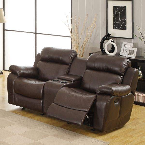 Sit down, kick back and get ready to enjoy the big game in this Eland Brown glider recliner loveseat from Tribecca Home. The brown bonded leather upholstery has a soft, luxurious feel and a rich, hand