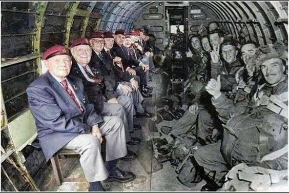 World War II paratroopers sitting across from themselves in the same plane that dropped them into Normandy on D-Day.