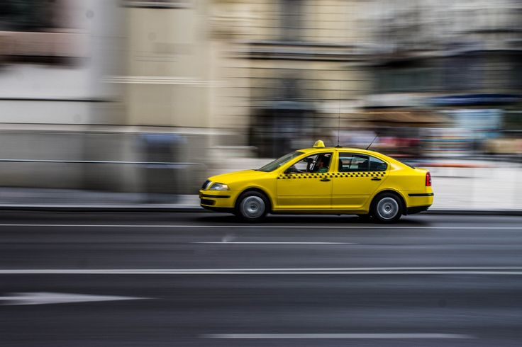 A Hungarian yellow cab in motion
