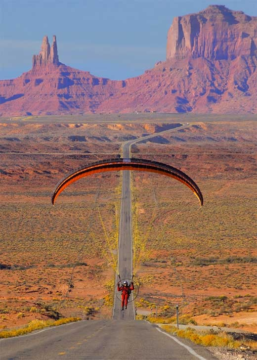 Paragliding in Monument Valley, Utah. This panorama was used in the movie Forrest Gump, as he was jogging across America. © Robert Kittila