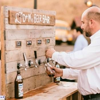 #weddingideas #weddingreception #weddings Hiring waiters and servers can add up really quickly. Instead of having an open bar, just set up a keg-style beer bar instead, and dress it up with a cute DIY wood panel so it looks like real beer taps.