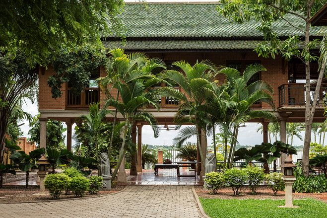 This Pan-Asian-style home sits along the Mekong River on the outskirts of Phnom Penh, Cambodia. Belgian architectural consultant Jean De Spiegeleer and his Khmer wife Sok Lita built the home on a former banana plantation between 2001 and 2002.