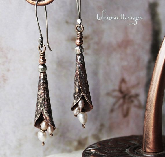 Peaches and Creamy Freshwater Pearls are threaded onto Bronze Wire and loosely hanging inside a Lilly of Reticulated Silver (Fine Silver paste melted onto Copper). Dangles on Sterling Silver Ear Wires made by me Measures 4.5cm in length (1.77) long from bottom of earwires to the