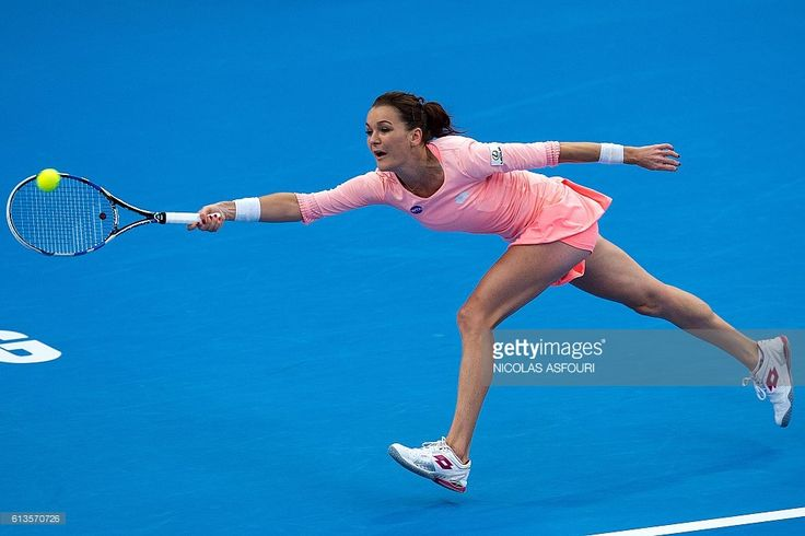 Agnieszka Radwanska of Poland hits a return against Johanna Konta of Britain during the women's singles final of the China Open tennis tournament in Beijing on October 9, 2016. / AFP / Nicolas ASFOURI
