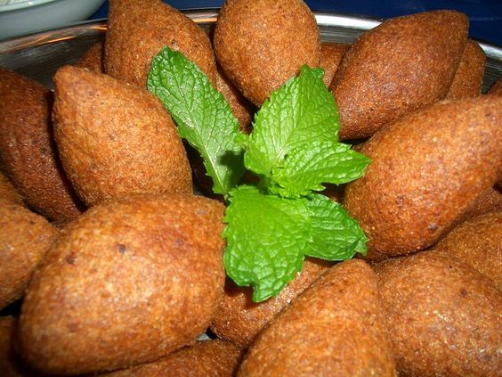 Kibbeh or kibbe (also kubbeh, kebbah or kubbi) (Arabic: كبة‎) is an Arab dish made of bulghur, minced onions and ground red meat. Kibbeh is a popular dish in Levantine cuisin, widespread in Syria, Lebanon, Jordan, Iraq, Iran, Egypt (kebbah/koubeiba), Cyprus (koupes), Israel, the Palestinian territories,the Arabian Peninsula, Turkey (içli köfte), and some Latin American nations which received part of the Lebanese and Syrian diaspora during the early