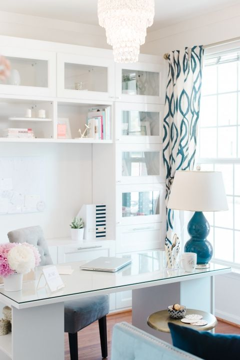 Chic and sleek office idea perfect for the home office. All white desk and built-ins with bold lamp and patterned drapery.
