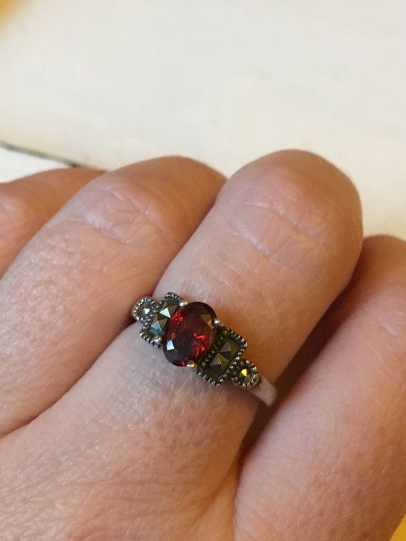 A beautiful gift for the January girl in your life! A pretty, oval garnet is flanked with 3 marcasites on either side. This could be worn along or stacked with some sterling bands. It is in great vintage condition and measures a 5.75 on my ring mandrel. Please note that individual computer monitors display colors differently. Please review my policies section, as I do not take returns unless there are unforeseen issues with the item. Know your ring size before purchasing, as I do not accept…