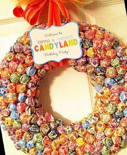 A Candy Wreath for a party. Made out of a huge bag of dum-dum lollipops! Stick each dum dum one by one into a styrofoam wreath