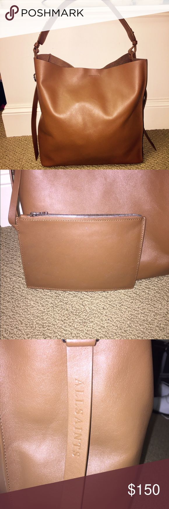 All saints Paradise North South Tote. Slouchy yet sleek, the Paradise North South Tote is a classic shape crafted from butter-soft lamb leather. Featuring a roomy interior with a handy zip pocket, it transitions from day to night effortlessly. Light caramel color   Single top handle. Magnetic closure. Interior zip pocket. Interior pouch pocket. Long strap extensions with ring detail. Structured base with 4 protective feet. Super-soft leather. Unlined. All Saints Bags Totes