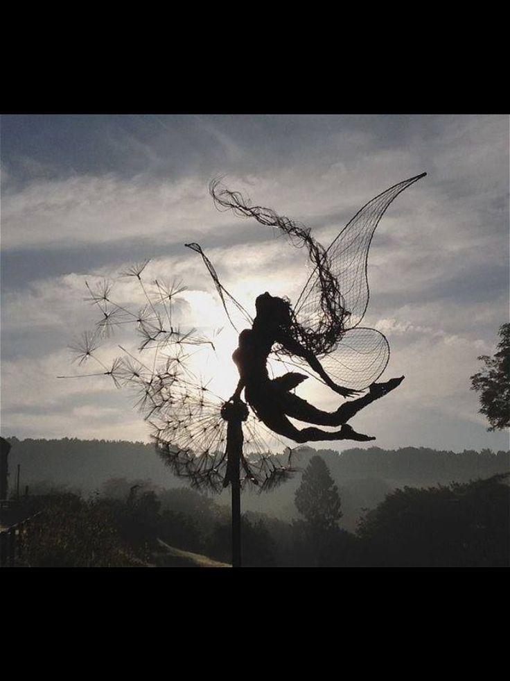 Fairy sculptures Dancing With Dandelions by Robin Wight