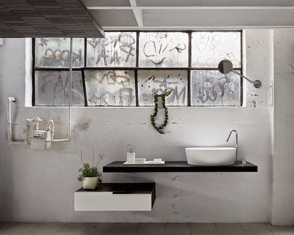 Inspiration for your bathroom | A large black shower and raw details