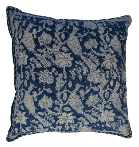 Printed natural cotton floral pattern cushion in blue and natural. The reverse has a complimenting subtle repeated floral design with surface detail in silver.  Hand block printed in India using ethical and environmentally friendly construction that preserves and celebrates traditional artisan skills.  100% natural cotton cover with NZ made Polyfill inner.  Dimensions: 45cm x 45cm