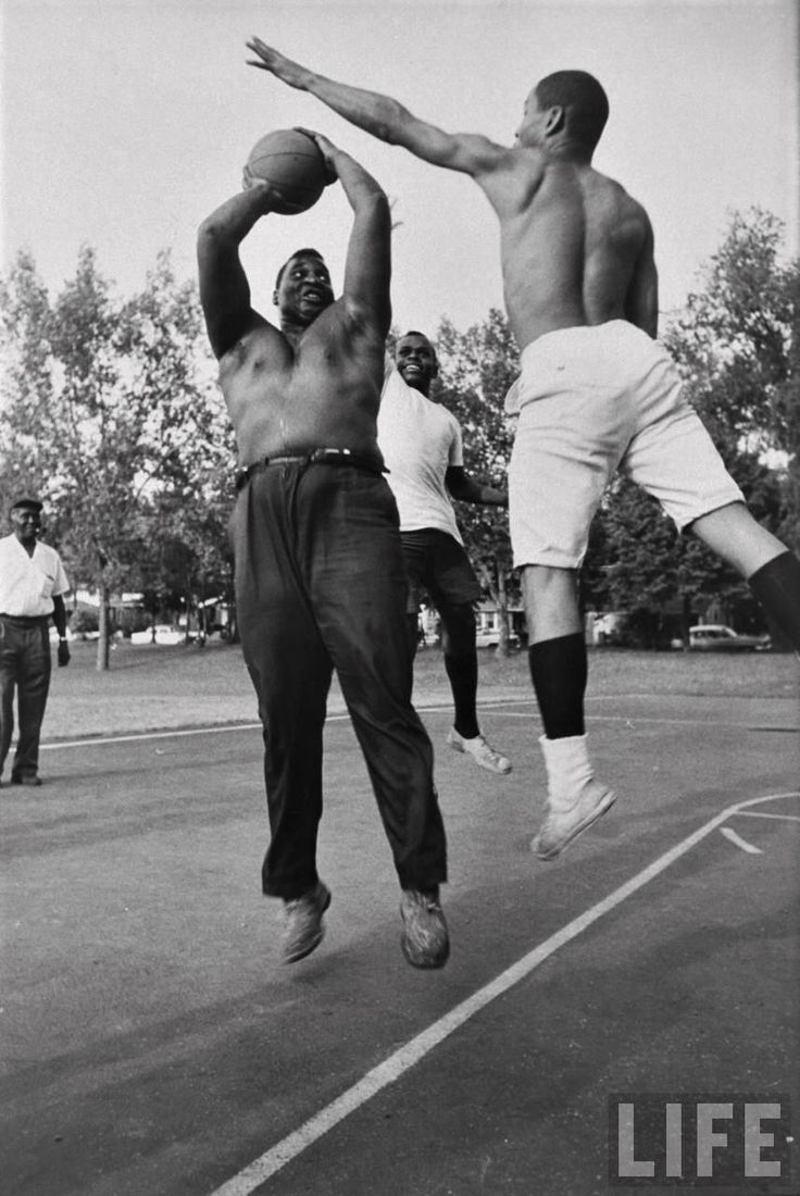 """""""Olympic boxing contender Buster Mathis playing basketball"""", by Art Rickerby, Grand Rapids, MI, 1964 via reddit"""