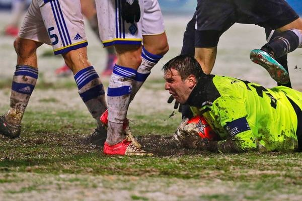 Dinamo Zagreb's Ivan Kelava makes a save during the Champions League Group A match between Dinamo Zagreb and Dynamo Kiev. The match was temporarily delayed due to heavy snow in the first half.