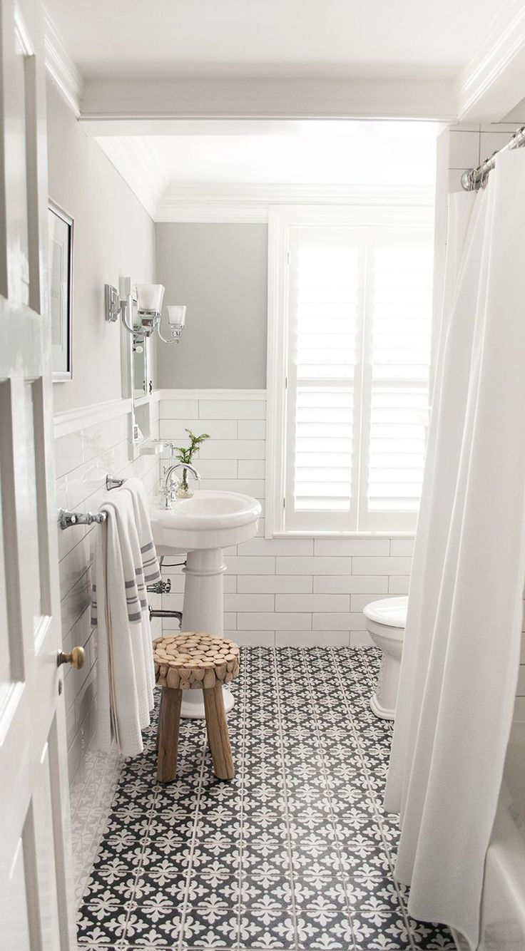 Love the mix of crisp white, soft dove gray and bold black and white patterned floor tiles!