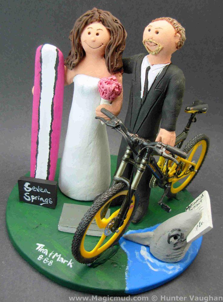 Cyclist groom weds surfer bride wedding cake topper http://www.magicmud.com   1 800 231 9814  magicmud@magicmud.com  http://blog.magicmud.com  https://twitter.com/caketoppers         https://www.facebook.com/PersonalizedWeddingCakeToppers $235  #cyclist#biker#bike#surfer#surfing#surf#ocean#wave#beach#longboard#catch-a-wave#waveRider