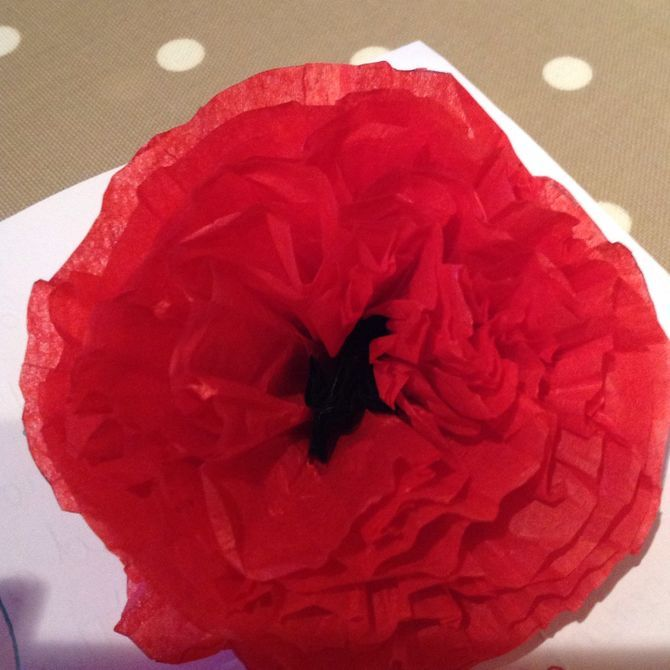 Poppies are big, bold blooms that are bound to put a smile on any face. If it isn't poppy season and you don't have access to the beautiful flowers, create your own out of tissue paper and a few simple craft items. Use your tissue paper...