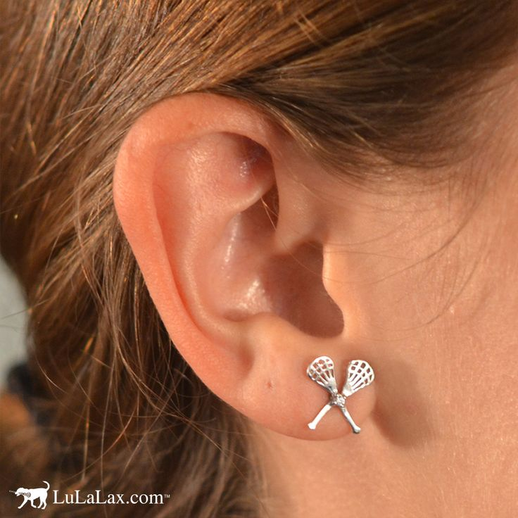 Let your ears sparkle with your lacrosse passion! Our sterling silver earrings, featuring tiny lacrosse sticks and a cubic zirconia stone, make the perfect fashion statement for any lacrosse girl. LuLaLax.com