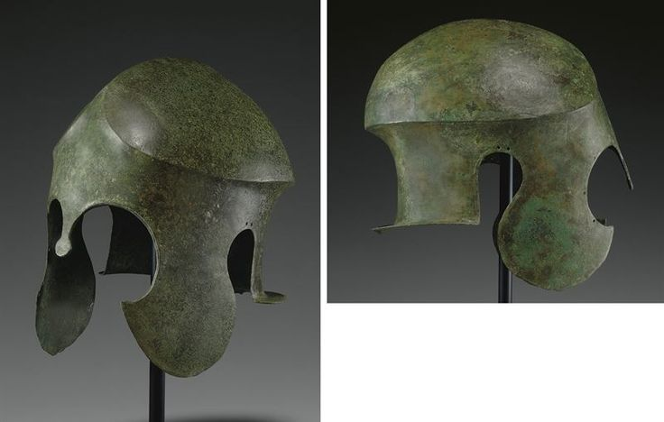 Chalcidian helmet, archaic period, 2nd hald of the 6th century B.C. Of hammered sheet, the crown with a carinated edge that peaks at the front where it merges with the sharp median ridge, the carination especially pronounced at the back, with long crescentic cheek-pieces, the small nose-guard terminating in a disk, the neck-guard flanged, a reinforcing band joined by rivets applied around the perimeter of the eye-holes, 26.7 cm high. Private collection, from Christie's auction