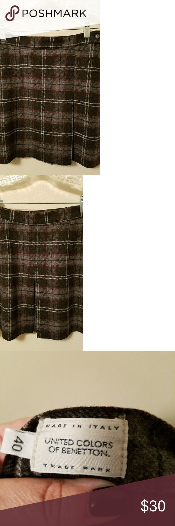 United Colors of Benetton Wool Blend Mini Skirt United Colors of Benetton wool blend mini skirt, European size 40, US size 8. Fully lined, side zipper, two front pleats, one back pleat. Adorable, slimming line. Dark grey, light grey, silver, burgundy plaid. Reads grey. Excellent used condition - never worn.   No trades at this time. Happy poshing! United Colors Of Benetton Skirts Mini