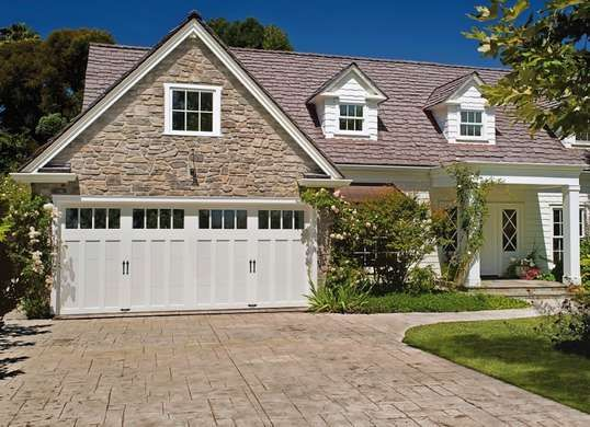 Garage doors with panels and windows