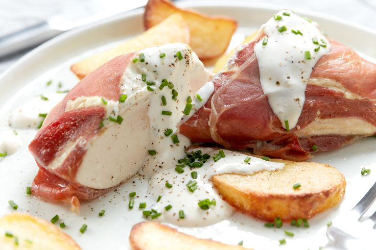 Chicken Breast wrapped in Parma Ham with White Wine and Garlic Cheese Sauce