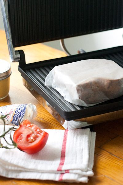Tip: Enjoy hot panini sandwiches without the mess. A hot, cheesy sandwich with tomato, roasted red pepper, a few capers, and a healthy slather of olive tapenade is delicious and, inevitably, messy. Wrap your sandwich in parchment paper before putting them in your press; it'll create a little envelope for messy cheeses and oils and keep them off your machine.