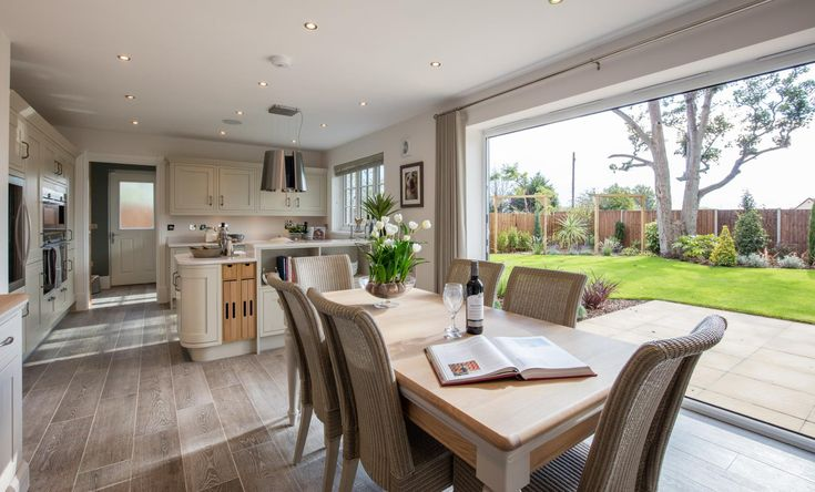 An open plan layout allows for flexible living. Here, bi-fold doors create a transition from outdoor to indoor living - so you can get the best of both worlds and enjoy flooding your home with natural light and fresh air.